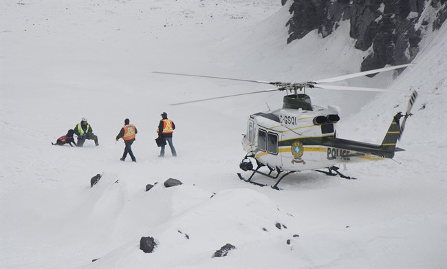 Rescuers prepare to search for workers in a quarry at L'Epiphanie, Que., Tuesday, January 29, 2013, following a landslide where a number of vehicles fell into the quarry. Two workers are missing. THE CANADIAN PRESS/Graham Hughes.