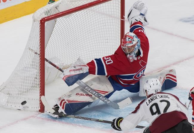 Montreal Canadiens goaltender Cayden Primeau makes a save against Colorado Avalanche's Gabriel Landeskog during second period NHL hockey action in Montreal, Thursday, December 5, 2019. THE CANADIAN PRESS/Graham Hughes