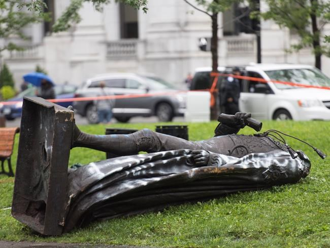 The statue of Sir John A. MacDonald is shown torn down following a demonstration in Montreal, Saturday, Aug. 29, 2020, where they protested to defund the police with a goal to end all systemic racism within all sectors of the Canadian government. THE CANADIAN PRESS/Graham Hughes