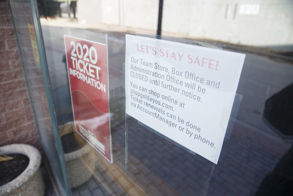 A sign taped to the doors of the empty Winnipeg Goldeyes stadium Wednesday morning. The Goldeyes organization laid off 15 full-time staff last week.
