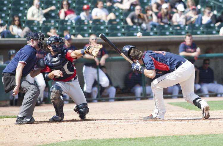 Saltdogs third baseman Mike Provencher is hit in the head by a pitch from the Goldeyes' Aaron Correa during Sunday's game. The final score was Lincoln 11, Goldeyes 2.