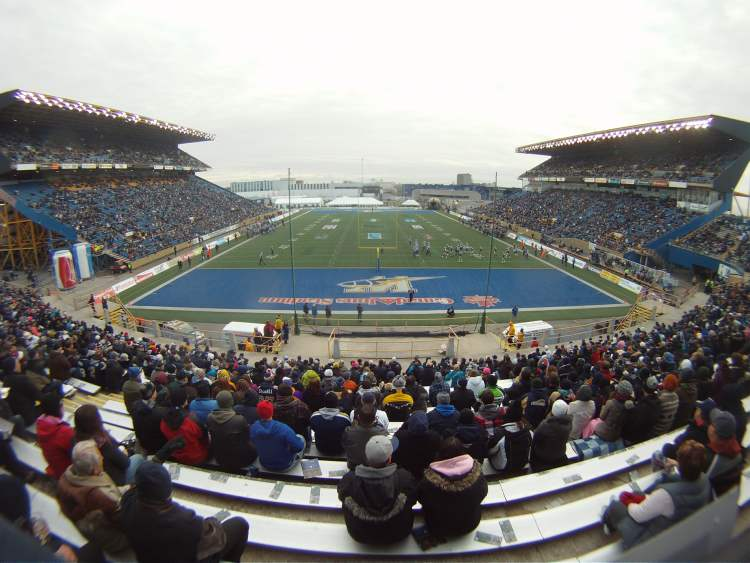 Fans in the stands watch the Bombers' final game of the season.