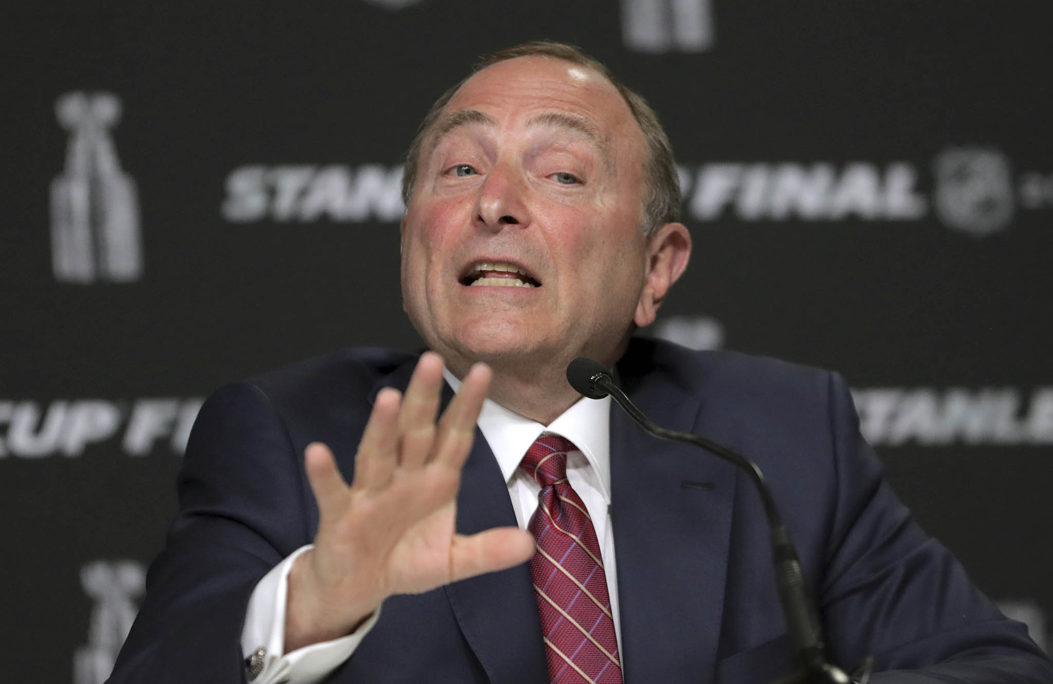 NHL commissioner Gary Bettman was asked to confirm the logo of each team before the ball was dropped.