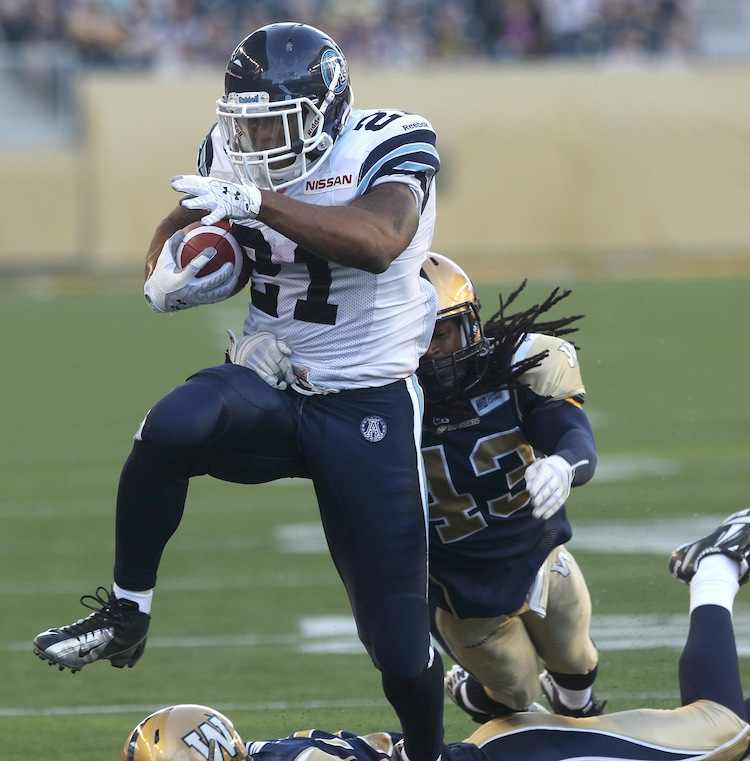 Gerald Riggs of the Toronto Argonauts scores the first touchdown at Investors Group Field, putting the Argos ahead 7-3 in the second quarter. (JOE BRYKSA / WINNIPEG FREE PRESS)