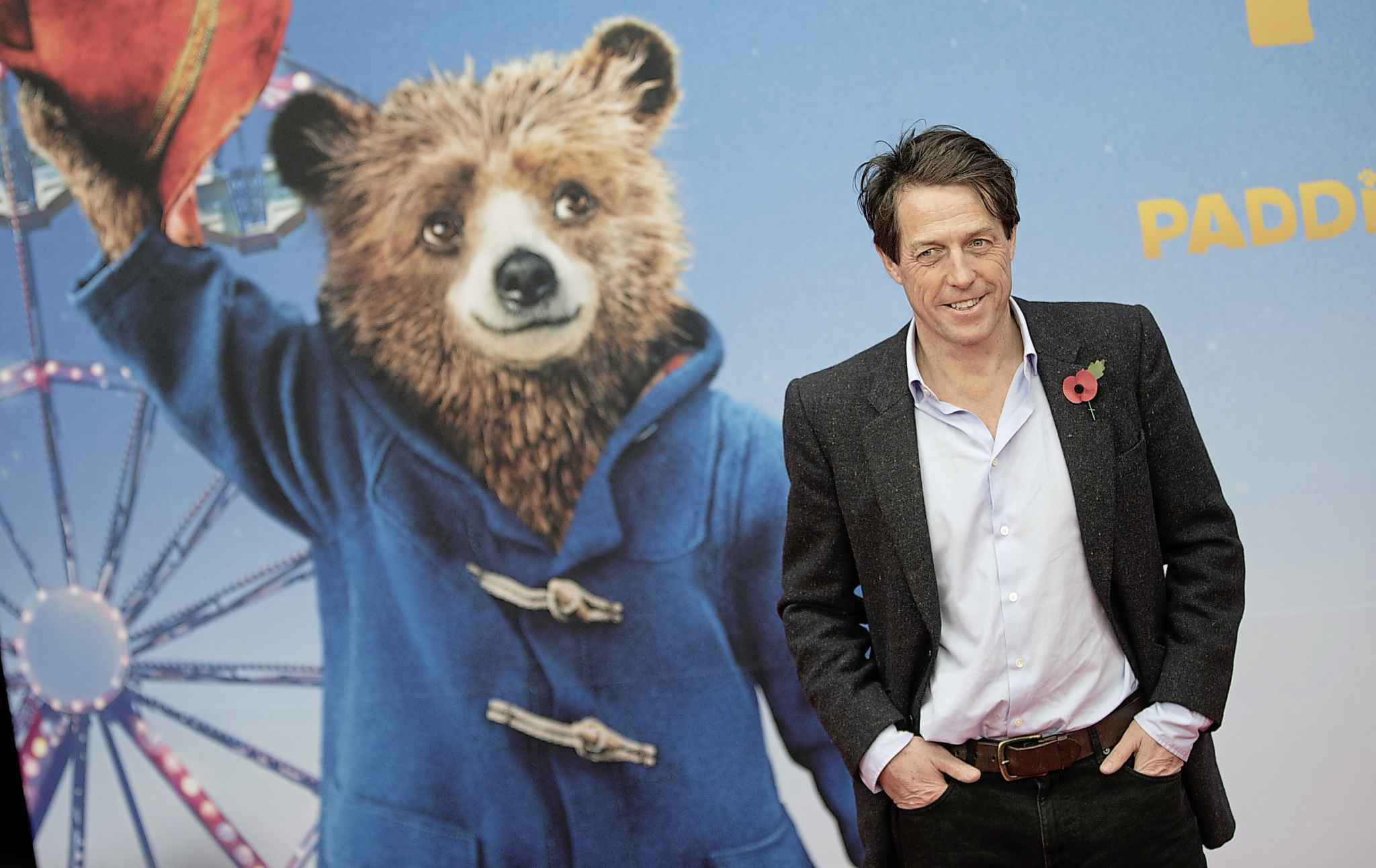 Paddington 2 ends with a big Hugh Grant musical production number. My goodness, what's not to like? (Joerg Carstensen/dpa via AP)