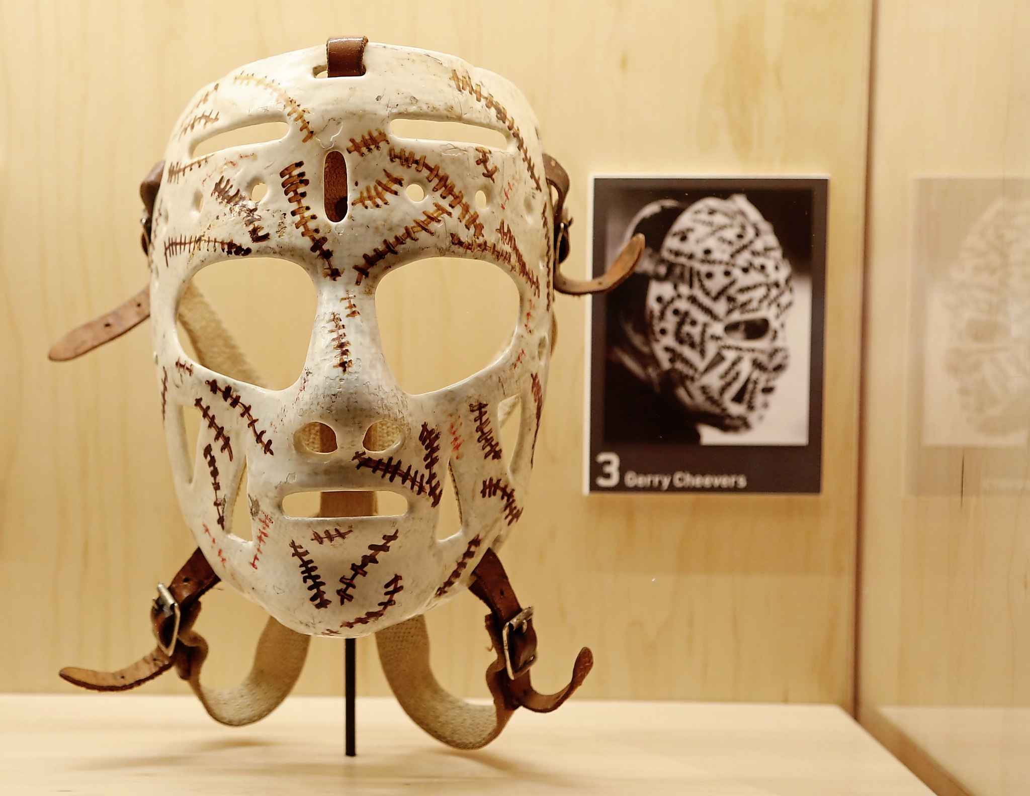 "Gerry Cheevers' goalie mask, with the ""stitches"" he added whenever a puck hit his mask. (Patrick Doyle / Canadian Press files)"