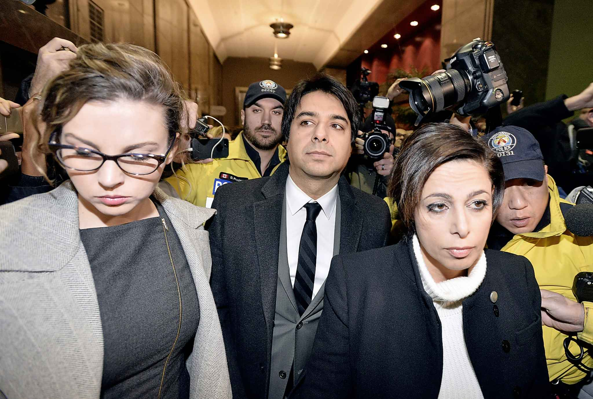 Jian Ghomeshi, centre, and his lawyer Marie Henein, right, leave a Toronto court in 2015.