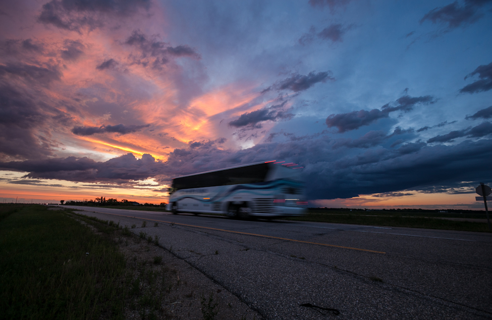 The bus carrying the Goldeyes back to Winnipeg from Iowa speeds along Manitoba Highway 75 at sunrise on the morning following their road trip.