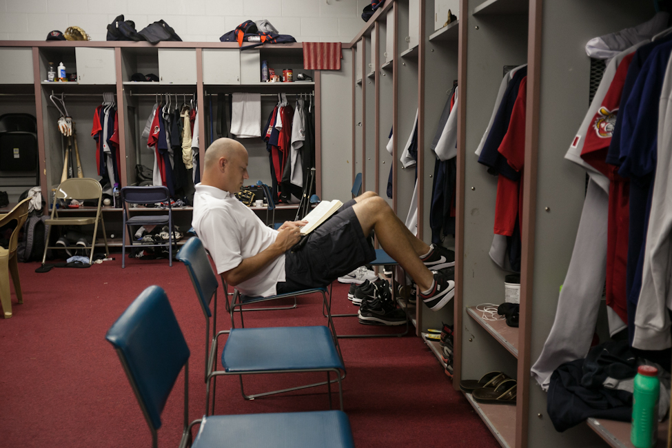 Prior to the starting the Sunday game against Sioux City, pitcher Ace Walker read The Book of God - the bible written in novel form - quietly in the clubhouse. (Melissa Tait / Winnipeg Free Press)