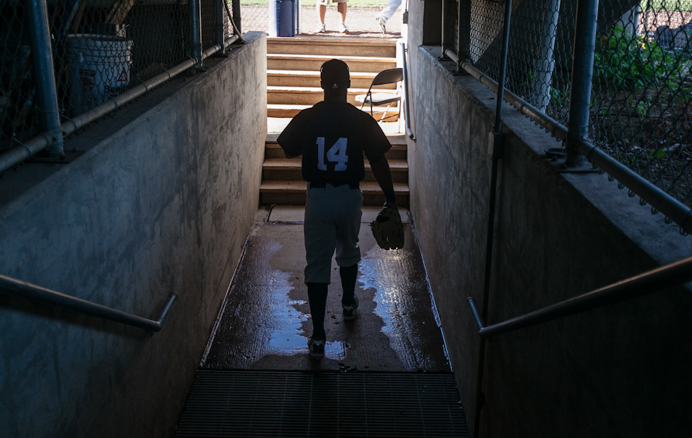 Infielder Price Kendall heads under the bleachers into the dugout at Lewis and Clark stadium in Sioux City.