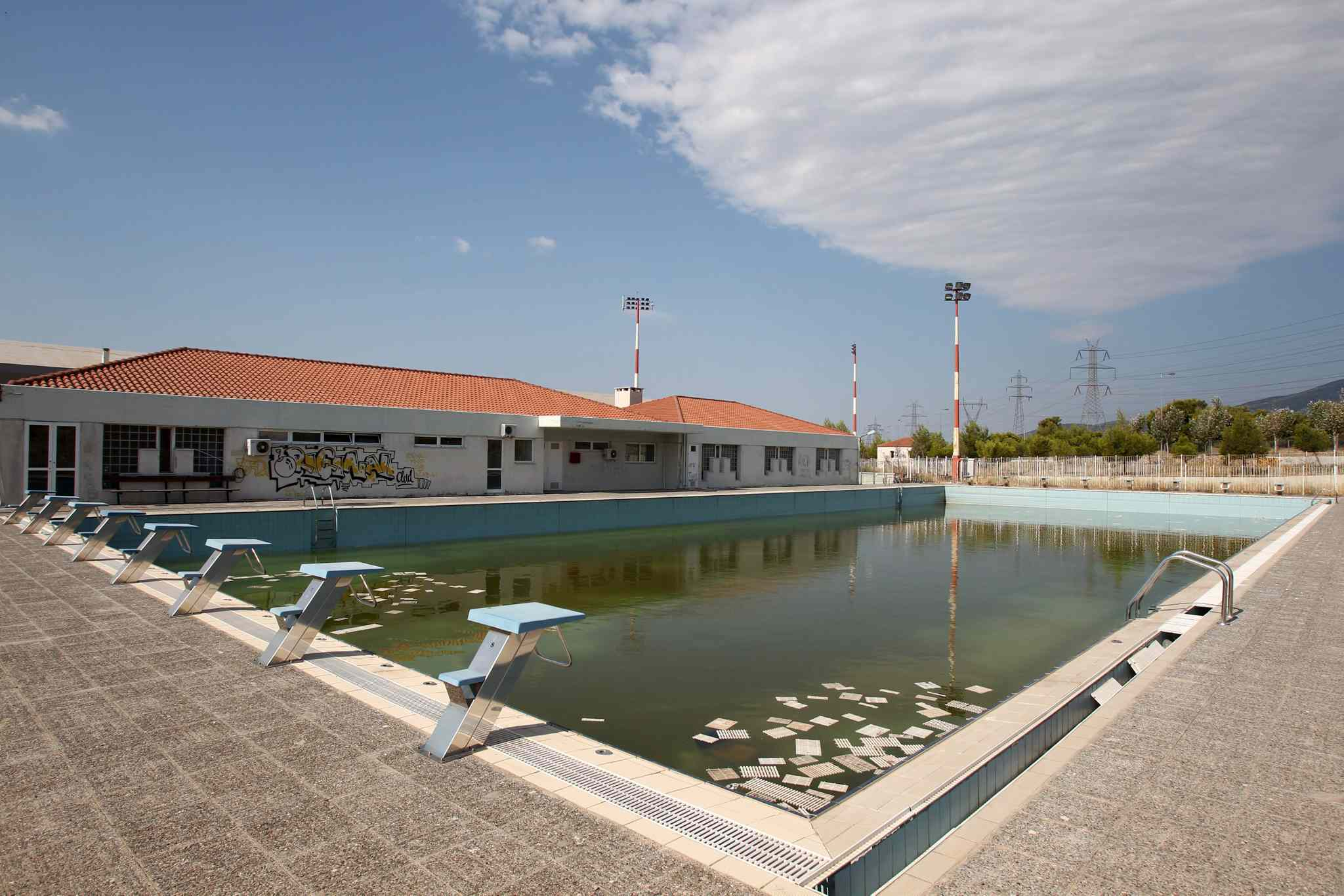 Murky water and rubbish fill an abandoned training pool for athletes at the Olympic village on the northern fringes of Athens. Some critics say that the multibillion dollar cost of the Greek games played a modest role in the nation's 2008 economic meltdown.