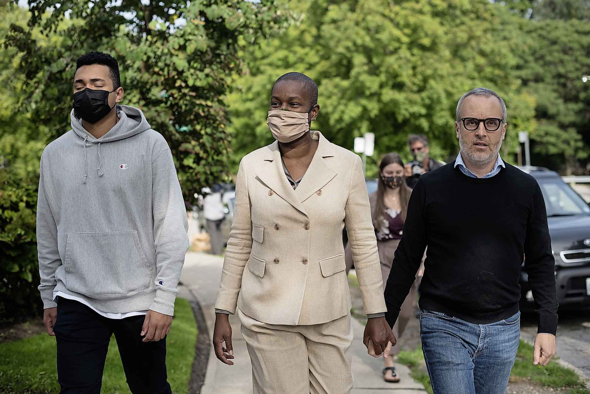 Annamie Paul holds hands with her husband, Mark Freeman, as they walk alongside their son, after a press conference announcing she is officially stepping down as Green Party leader, at Suydam Park in Toronto on, Monday, September 27, 2021. THE CANADIAN PRESS/ Tijana Martin