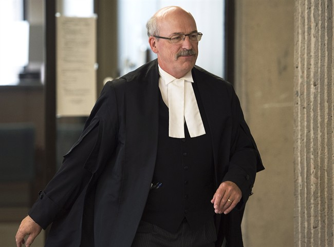 Don Murray, lawyer for Andre Noel Denny, walks from Supreme Court in Halifax onTuesday, Sept. 2, 2014. Denny is charged with second-degree murder in the beating death of 49-year-old Raymond Taavel in April 2012. THE CANADIAN PRESS/Andrew Vaughan