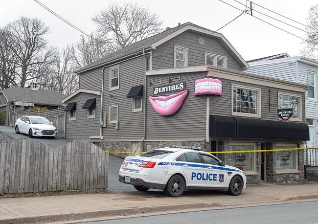 The Atlantic Denture Clinic is guarded by police in Dartmouth, N.S. on Monday, April 20, 2020. The business is owned by alleged killer Gabriel Wortman. Police say 17 people are dead, including RCMP Const. Heidi Stevenson, after a man went on a murder spree in several Nova Scotia communities. Wortman, 51, was shot and killed by police. THE CANADIAN PRESS/Andrew Vaughan