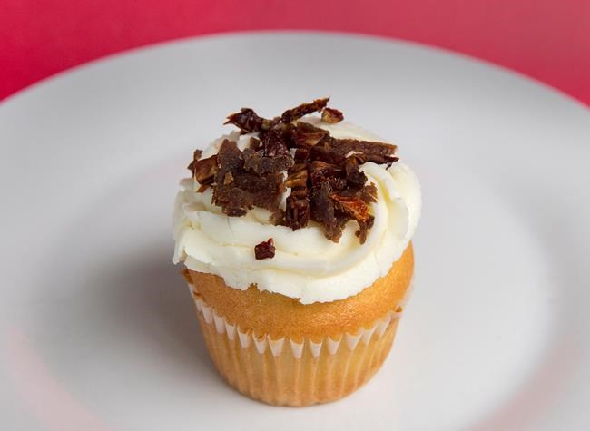 A donair cupcake is seen in Halifax on Thursday, Dec. 6, 2018. Two local businesses, King of Donair and Susie's Shortbreads, collaborated to construct the epicurean delight which features vanilla cake paired with donair meat baked in, topped with delicious donair sauce cream cheese frosting and sprinkled with candied donair meat. The THE CANADIAN PRESS/Andrew Vaughan