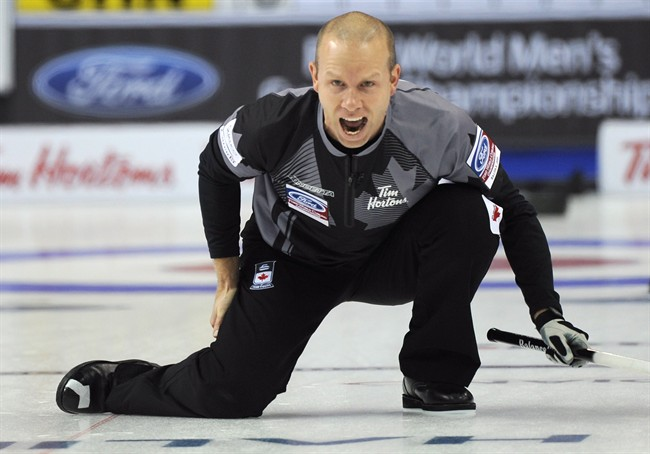 Canada's Pat Simmons shouts down the ice during the world men's curling championship against China in Halifax on Sunday, March 29, 2015. Canada defeated China 7-4. THE CANADIAN PRESS/ho-Michael Burns