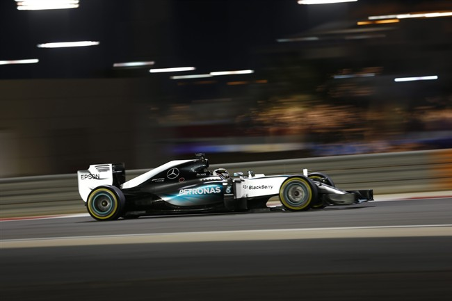 Mercedes driver Lewis Hamilton of Britain steers his car during the Bahrain Formula One Grand Prix at the Formula One Bahrain International Circuit in Sakhir, Bahrain, Sunday, April 19, 2015. (AP Photo/Hassan Ammar)