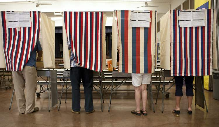 Voters cast their ballots at Waikiki Elementary on Election Day, in Honolulu.  (Marco Garcia / The Associated Press)