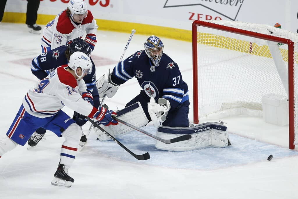 A heroic performance by Winnipeg Jets goaltender Connor Hellebuyck on Saturday helped his team defeat the Montreal Canadiens even though the Jets were badly outplayed. THE CANADIAN PRESS/John Woods