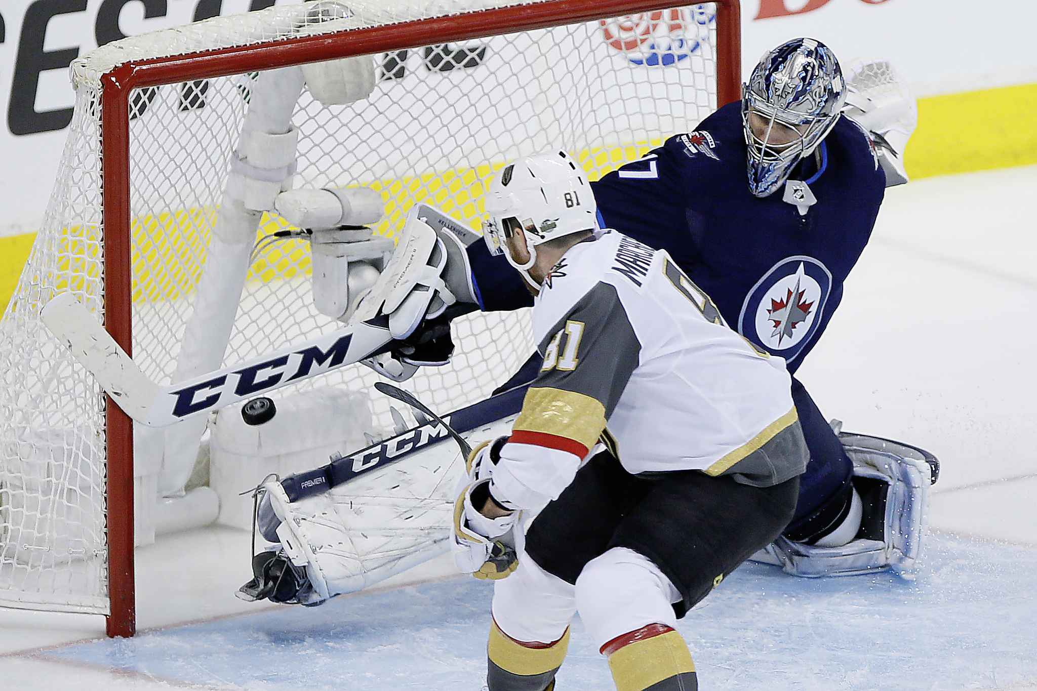 Vegas Golden Knights' Jonathan Marchessault  scores on Winnipeg Jets goaltender Connor Hellebuyck during the third period, Monday.