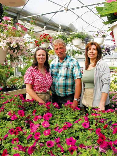 (Left) Don and Joan Paterson and Angie Sveinson at D.J. Paterson Garden Centre in June 2012. The Patersons are preparing to reopen for the season later this month.