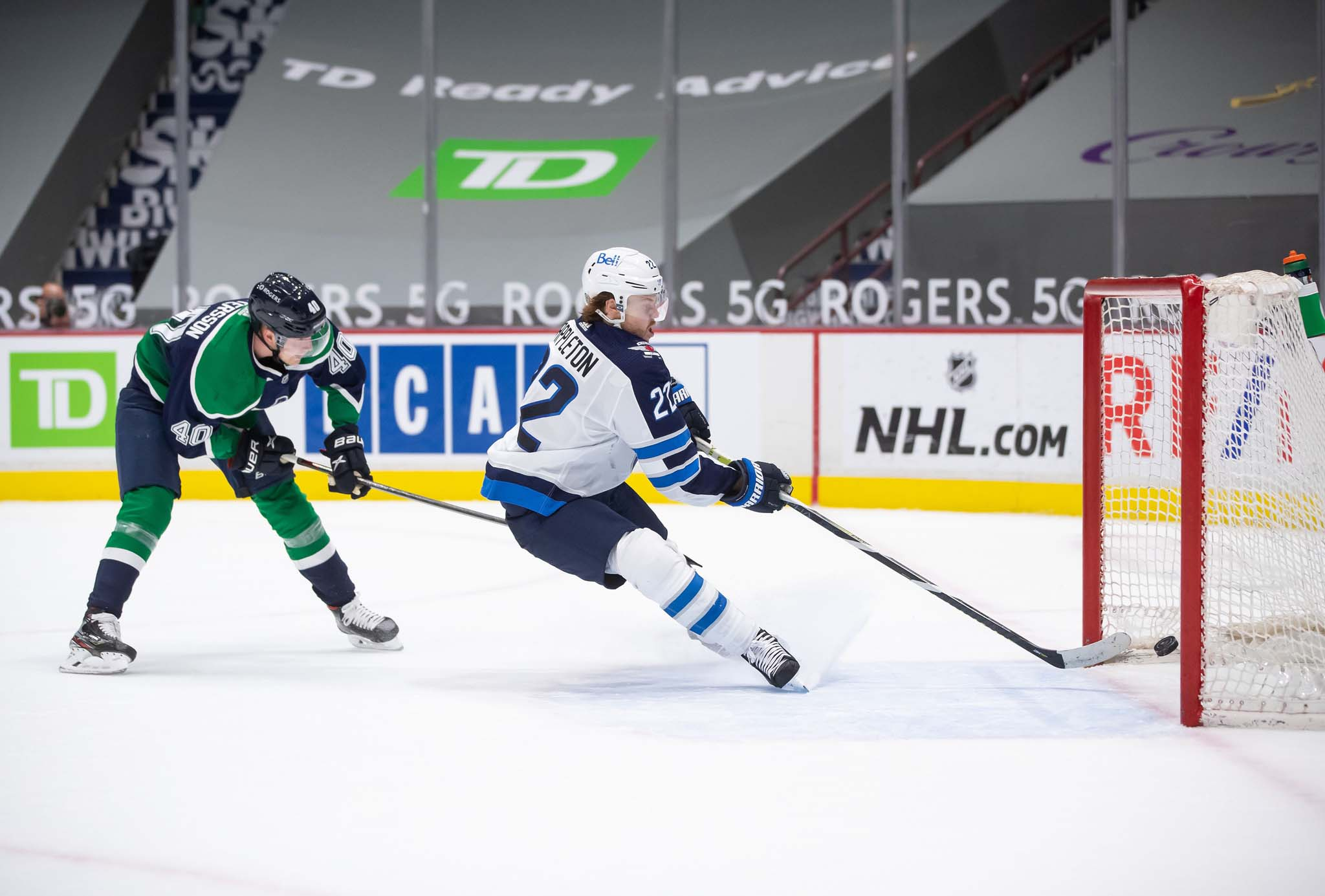 Appleton scores an empty net goal in front of Vancouver Canucks' Elias Pettersson during the third period in February.