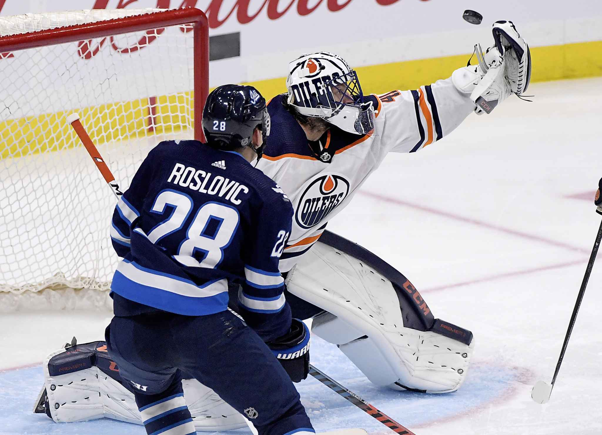 Edmonton Oilers Mike Smith makes a save on  Roslovic Sunday.