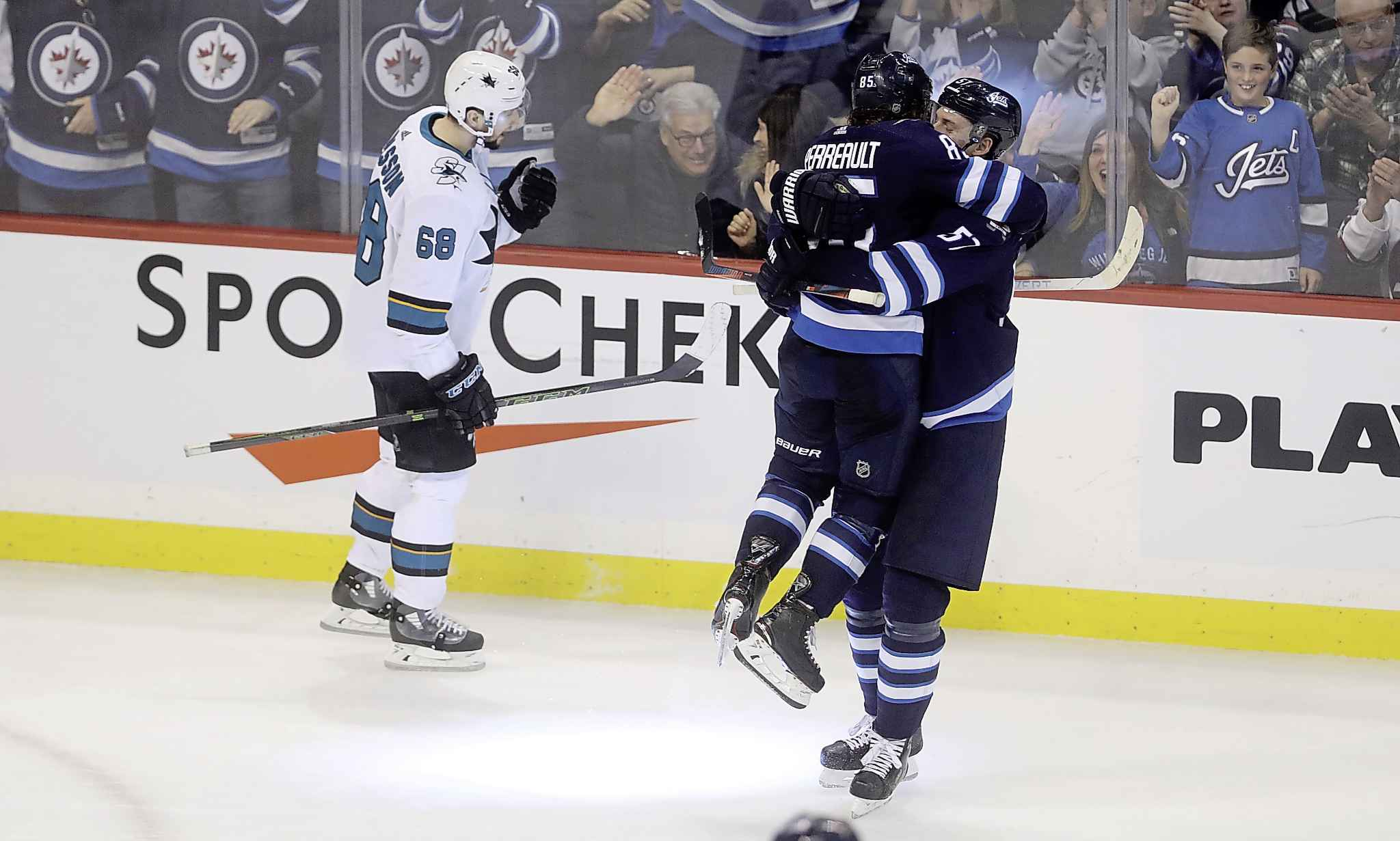 Winnipeg Jets' Mathieu Perreault (85) and Tyler Myers (57) celebrate after Perreault scored to tie the game against the San Jose Sharks during third period. TREVOR HAGAN / THE CANADIAN PRESS