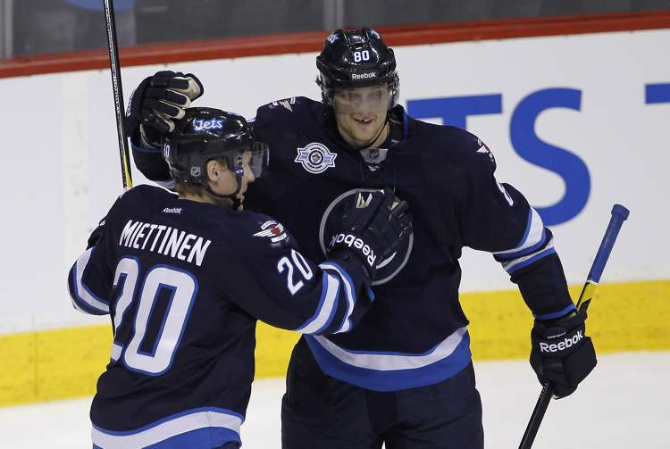 Winnipeg Jets' Antti Miettinen and Nik Antropov celebrate after Antropov scored against the Carolina Hurricanes' at the MTS Centre Sunday.