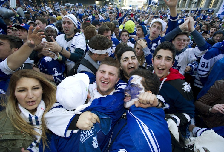 Toronto Maple Leafs fans celebrate the team's first goal while watching the game at Maple Leafs Square in Toronto. (Frank Gunn / The Canadian Press)