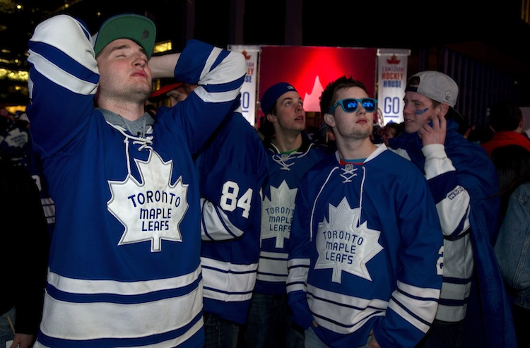 Toronto Maple Leafs fans react to the team's 5-4 overtime loss to the Boston Bruins while watching from Maple Leafs Square in Toronto.