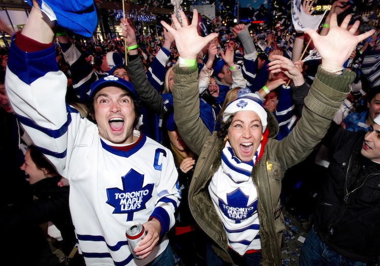 Toronto Maple Leafs fans celebrate the Leafs fourth goal, making the game 4-1,  while watching the game from Maple Leafs Square in Toronto.