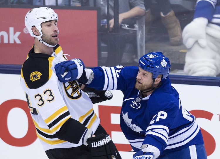 Toronto Maple Leafs forward Colton Orr, right, hits Boston Bruins defenceman Zdeno Chara during the first period of Wednesday night's game. (Nathan Denette / The Canadian Press)