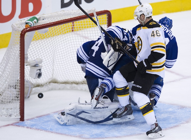 Boston Bruins forward David Krejci puts the puck past Toronto Maple Leafs goalie James Reimer during the second period of Wednesday night's game at the Air Canada Centre in Toronto. (Nathan Denette / The Canadian Press)
