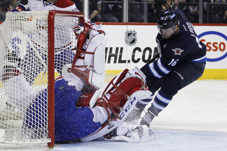 Montreal Canadiens' goaltender Carey Price gets his glove on Winnipeg Jets' Andrew Ladd's rebound during the second period. (JOHN WOODS / The Canadian Press)