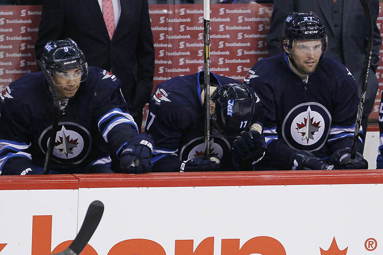 Winnipeg Jets' James Wright (17), Evander Kane (9) and Eric Tangradi (27)shows their disappointment during the third period. (JOHN WOODS / The Canadian Press)