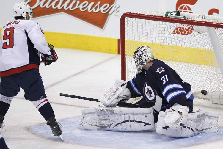 Washington Capitals' Mike Ribeiro scores on Winnipeg Jets goaltender Ondrej Pavelec in the third period of Saturday afternoon's game.