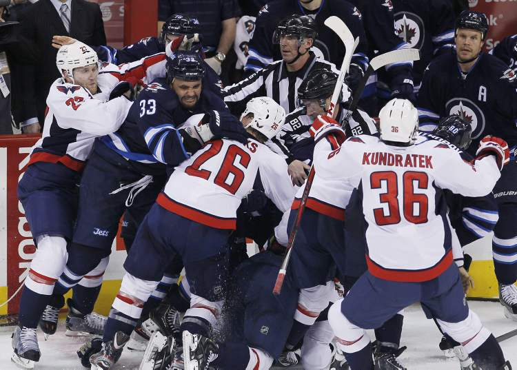 Winnipeg Jets and the Washington Capitals mix it up after a play during the third period of Saturday afternoon's game. (JOHN WOODS / the canadian press)