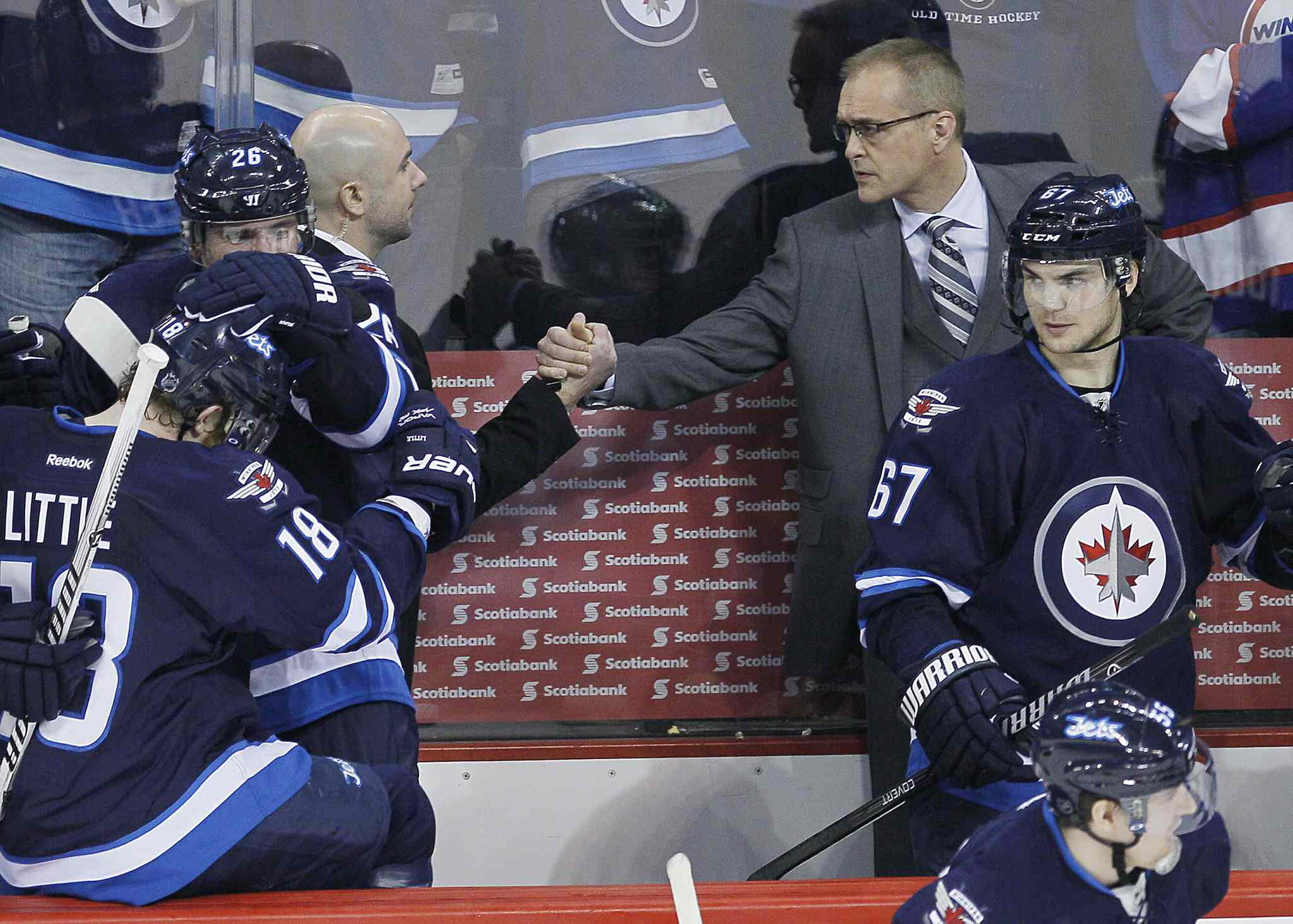 Winnipeg Jets' head coach Paul Maurice (right) and assistant coach Pascal Vincent congratulate each other after a shootout win over the Phoenix Coyotes in NHL action in Winnipeg on Thursday.