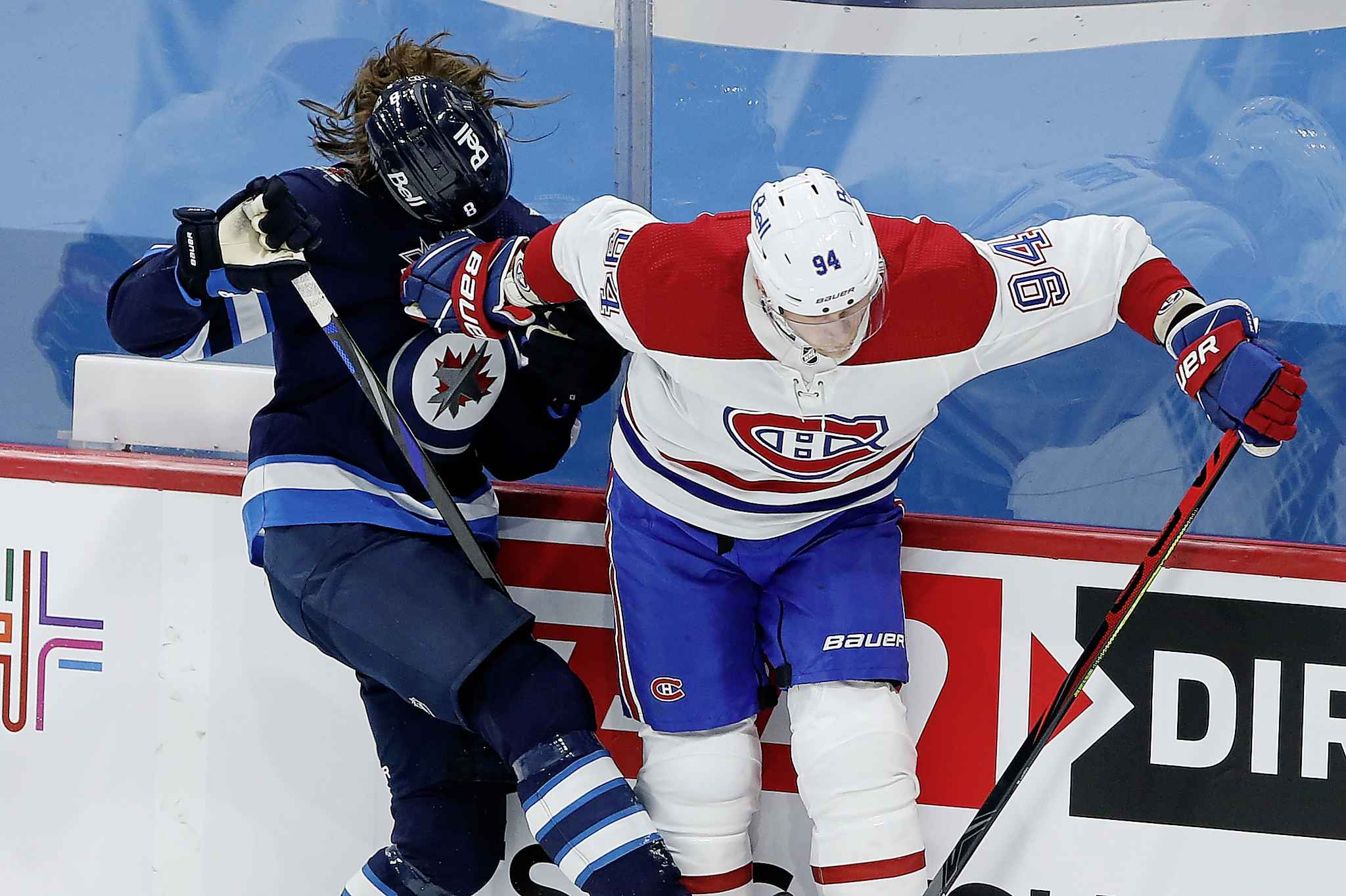 Winnipeg Jets' Sami Niku's (8) helmet flies after a collision with Montreal Canadiens' Corey Perry (94) during the first period. (John Woods / The Canadian Press)
