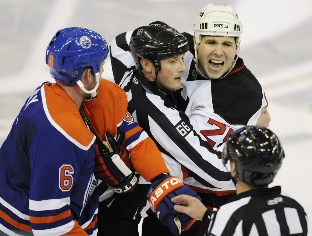 New Jersey Devils' Andrew Peters, 25, yells at referee, Rob Martell (right) in Edmonton in March 2010.