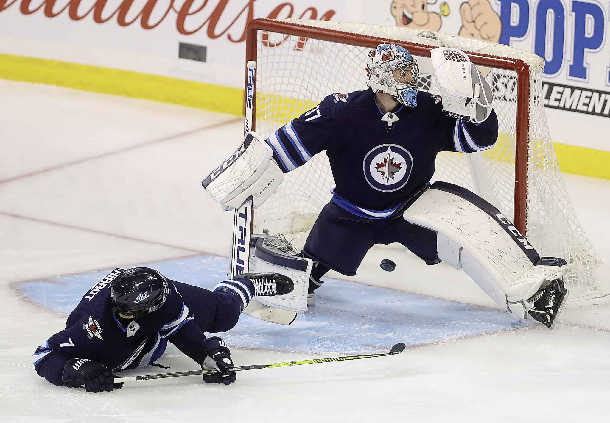TREVOR HAGAN / THE CANADIAN PRESS</p><p>A shot by Anaheim Ducks' Brian Gibbons (23), not shown, gets past Winnipeg Jets goaltender Connor Hellebuyck (37) with Ben Chiarot (7) in front of the net during first period NHL hockey action in Winnipeg, Sunday, January 13, 2019.</p>
