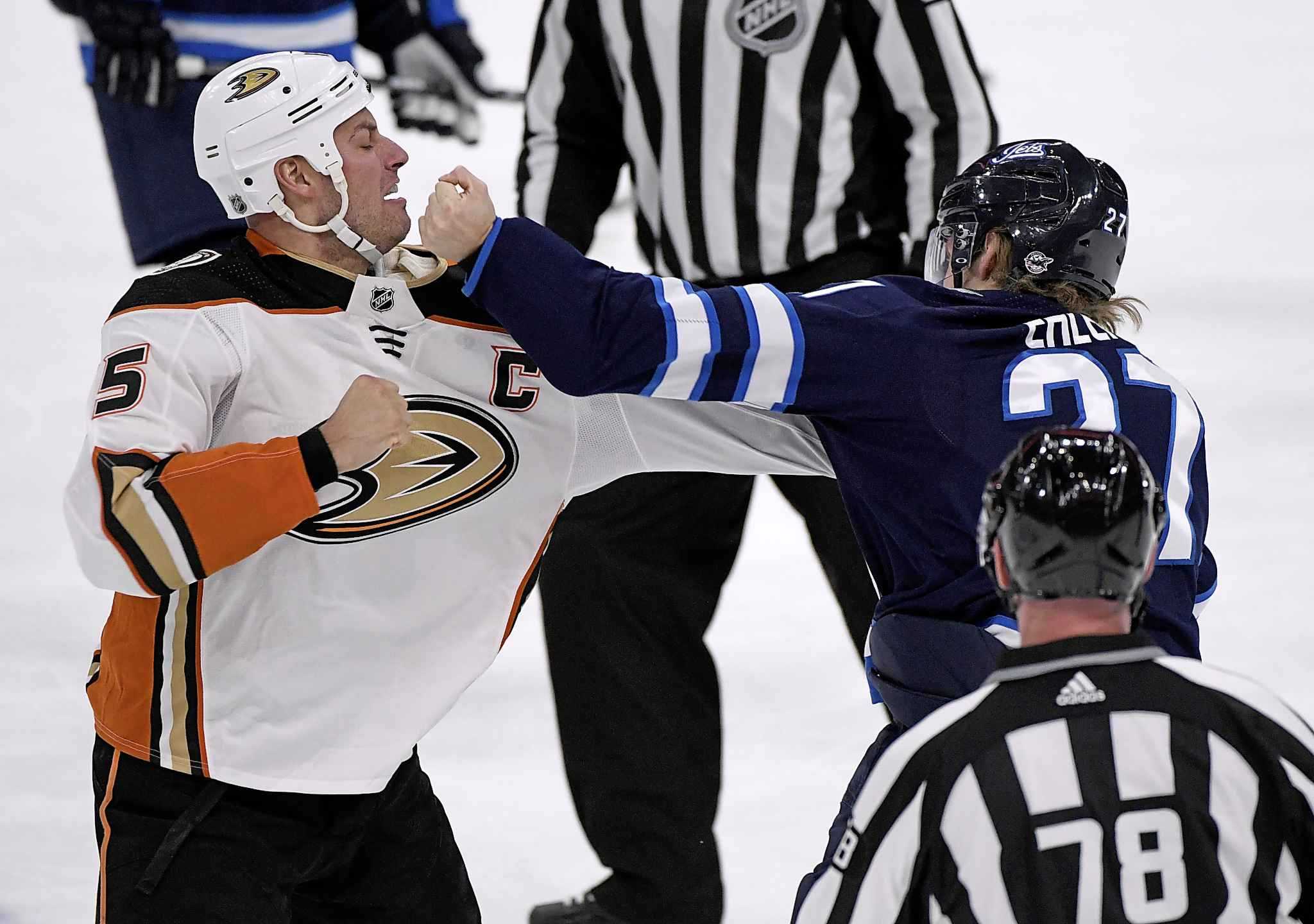 FRED GREENSLADE / THE CANADIAN PRESS</p><p>Winnipeg Jets' Nikolaj Ehlers (27) takes a swing at Anaheim Ducks' Ryan Getzlaf (15) as they fight during first period.</p>