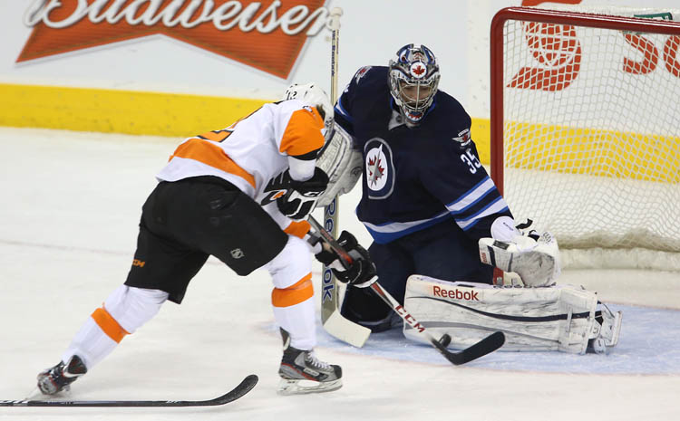 Winnipeg Jets' goaltender Al Montoya stop Philadelphia Flyers' Harry Zolnierczyk on a breakaway attempt in the first period Tuesday night.