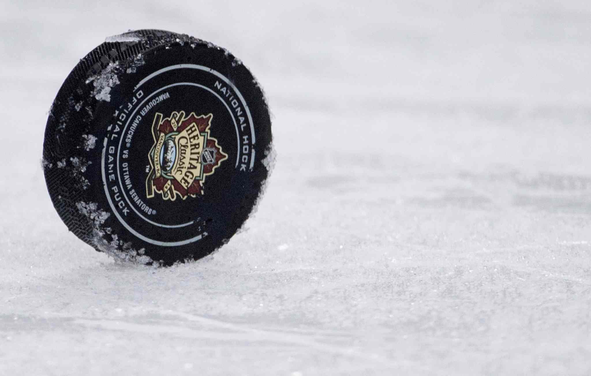 The puck is seen on the ice during the third period of the Heritage Classic hockey game between the Ottawa Senators and the Vancouver Canucks at BC Place in Vancouver, B.C. Sunday, March 2, 2014.