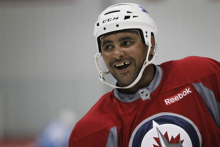 Winnipeg Jets' Dustin Byfuglien on the second day of NHL hockey training camp Thursday, in Winnipeg.