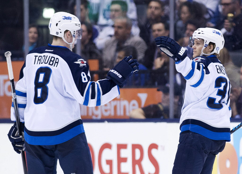 Winnipeg Jets defenceman Tobias Enstrom, right, celebrates his goal with teammate Jacob Trouba, left, while playing against the Toronto Maple Leafs during the second period.