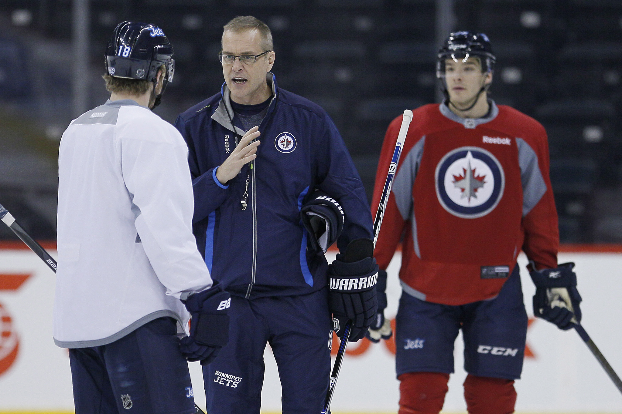 New head coach Paul Maurice talks with Bryan Little during his first practice.