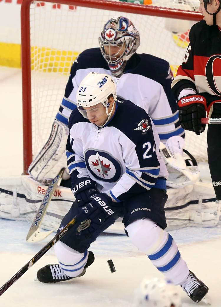 Winnipeg Jets defenceman Grant Clitsome blocks the puck in front of the Winnipeg net during second period NHL hockey between the Ottawa Senators and the Winnipeg Jets in Ottawa Saturday. (Fred Chartrand / The Canadian Press)