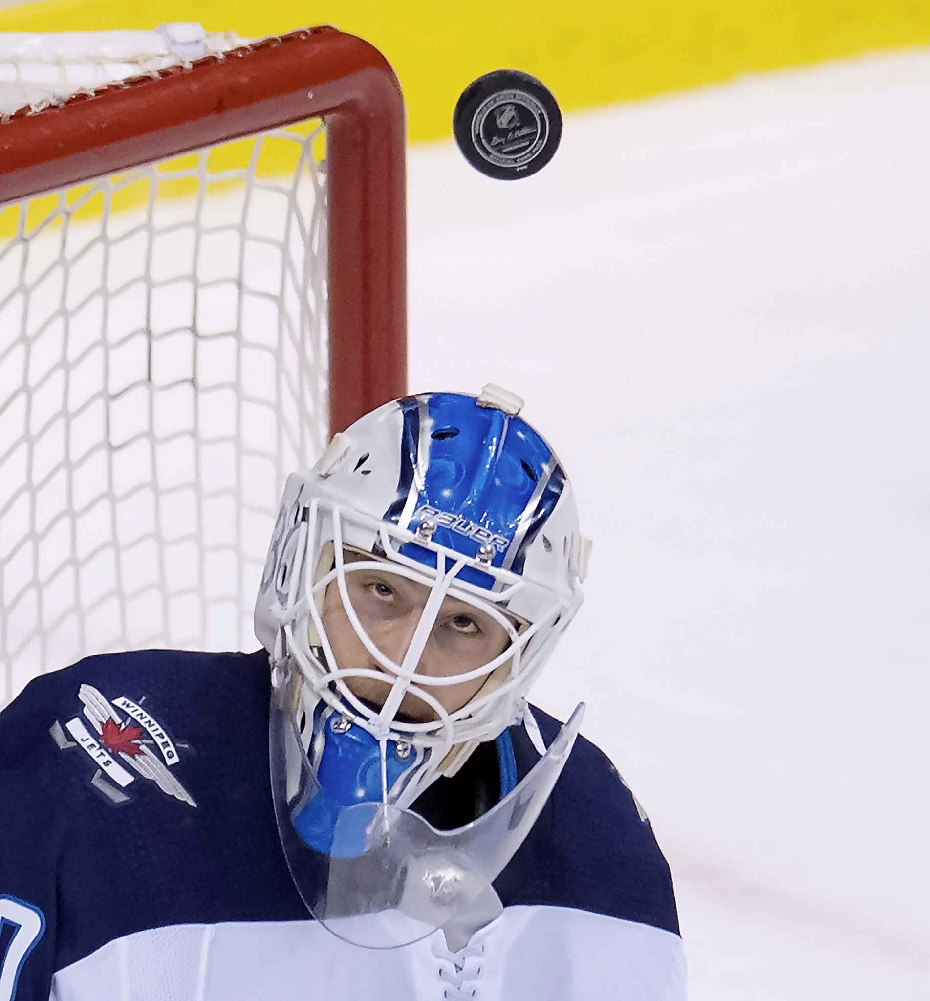 JONATHAN HAYWARD / THE CANADIAN PRESS FILES <p /> Winnipeg Jets goaltender Laurent Brossoit (30) keeps his eye on the puck during third period NHL action against the Vancouver Canucks at Rogers Arena in Vancouver, Saturday.